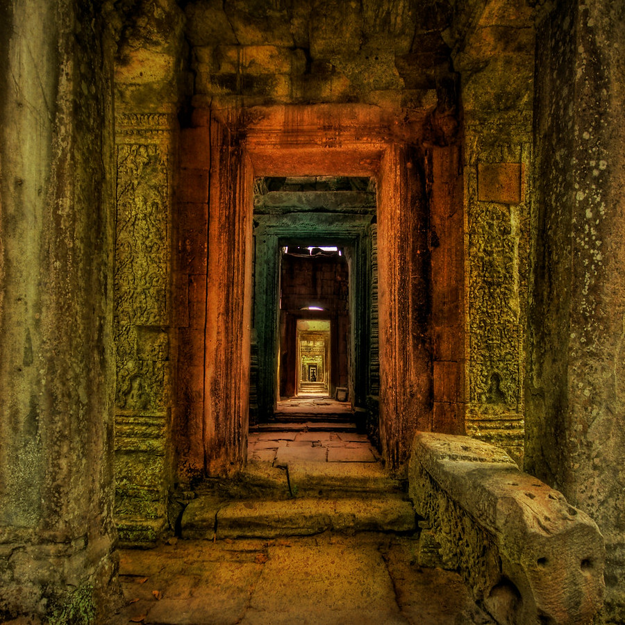 The Secret Passageway to the Treasure - Trey RatcliffAfter the crowds of Angkor Wat, it was nice to go find a remote temple in the jungle and be alone. This temple laid under the jungle, completely undiscovered for centuries.  The hallway and mysterious chambers seemed to go on forever.