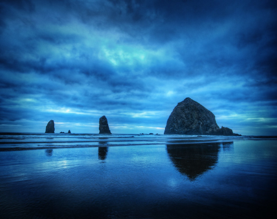 The Oregon CoastToday's photo comes from Cannon Beach, Oregon.  If you click through to the blog post here at the Stuck in Customs blog, you can see a brand-new video I made while taking this shot, explaining my thoughts on composition while I take the shot.- Trey Ratcliff