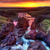 "<h2>The Solstice</h2> <br/>This came from one of my favorite nights in Iceland!  This was shot around 2 AM, right when I started feeling loopy.<br/><br/>I was on the edge of some precipitous volcanic rock, and there was a waterfall behind me.  It fed this little area of rapids that emptied out into one of the fjords.  There had been a light rain for a few hours, but the setting sun cut underneath the clouds to unleash some godly colors.<br/><br/>About 10-20% of my HDRs are in portrait mode.  I am just usually in landscape mode for some reason.  Part of it has to do with the way people consume these things -- on monitors.  I don't like making people scroll up and down to see a photo.  That's kind of a drag.  That's another reason I don't like those super-wide panoramas.  They are so difficult to pan around, even though there are a lot of slick tools.  It's just not a ""viewing"" experience while you are busy using a tool to manipulate the photo itself.  Do you know what I mean?<br/><br/>- Trey Ratcliff<br/><br/><a href=""http://www.stuckincustoms.com/2010/08/14/solstice-iceland/"" rel=""nofollow"">Click here to read the rest of this post at the Stuck in Customs blog.</a>"