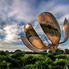 "<h2>Solar Flower - The Giant Robot of Buenos Aires</h2> <br/>This thing is enormous.  In grinds and churns as it follows the sun.  The metallic petals flex and bend with the light as the sun sweeps across the sky.  I had never seen anything like it in my life.  It sits in a park and public walking area of Buenos Aires, Argentina.  I walked around it for a while to get a good angle of the monster.  My tripod was stuck in customs, so I had to do this one handheld... and do my best to keep the camera as steady as a T-1000.<br/><br/>In less than 24 hours, I will endeavor to introduce a new type of photography to you guys.  I don't have a name for it.  It's experimental.  You'll have to help me come up with a good name for the technique.  People that get the <a href=""http://www.stuckincustoms.com/newsletter/"">Newsletter</a> (it's free!) will get a sneak peak tomorrow a little early.<br/><br/>- Trey Ratcliff<br/><br/><a href=""http://www.stuckincustoms.com/2009/10/13/solar-flower-the-giant-robot-of-buenos-aires/"" rel=""nofollow"">Click here to read the rest of this post at the Stuck in Customs blog.</a>"