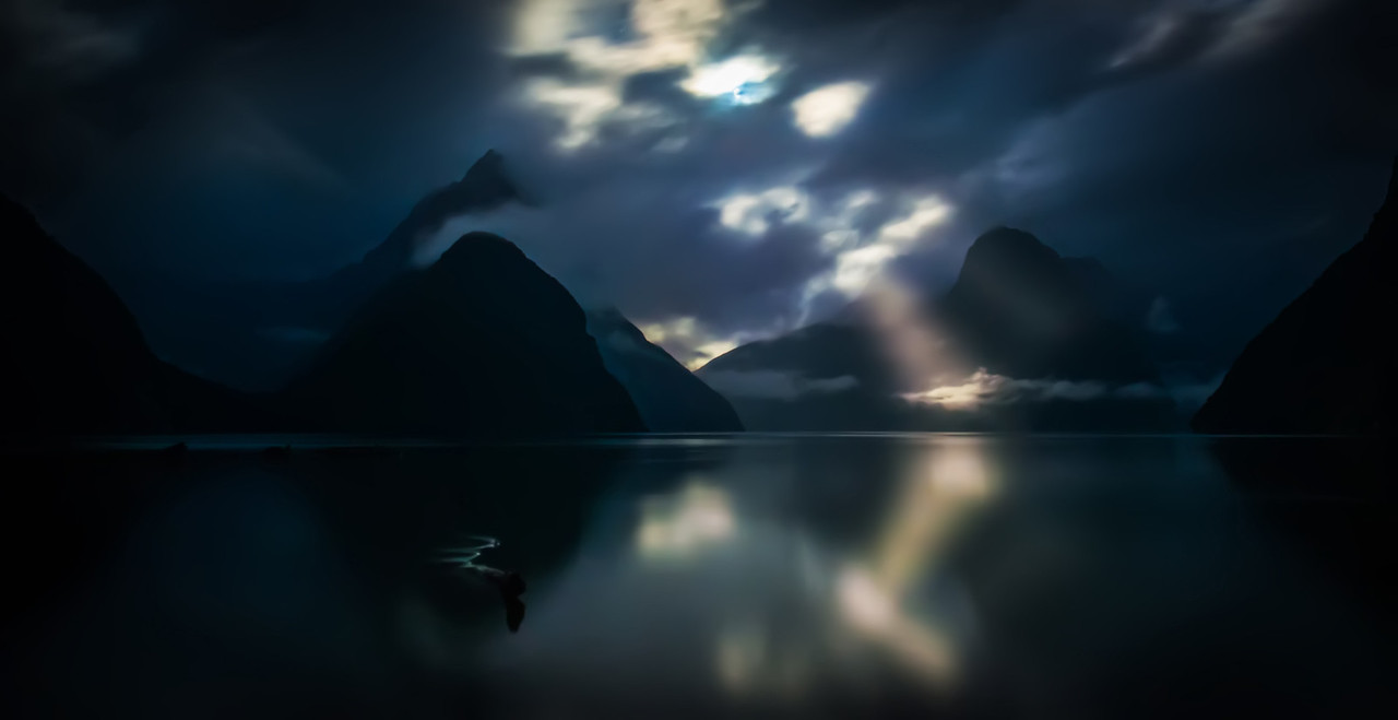 -Poems in the Moonlight in Milford Sound-  I stayed out late… way after the sun went down. The moon was out in full force, so I was getting all sorts of interesting shots. For the briefest of moments, the moon shot through one of the clouds towards one of the mountains that holds a glacier. I grabbed it as quick as I could!