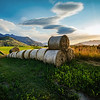"<h2>Hay for the Winter</h2> <br/>You may remember this photo from the New Zealand Landscape tutorial video I released. I'm glad everyone is enjoying those videos btw!<br/><br/>This is my first Autumn in Queenstown. I watched these fields grow all summer long, and it's cool to watch them all be cut down and rolled into these nice bales of hay. I notice that most farmers seem to wrap them up in plastic to protect them from the water… they are not as pretty then, so I was happy to get this photo before they were wrapped up!<br/><br/>- Trey Ratcliff<br/><br/><a href=""http://www.stuckincustoms.com/2013/04/21/hay-for-the-winter/"" rel=""nofollow"">Click here to read the rest of this post at the Stuck in Customs blog.</a>"