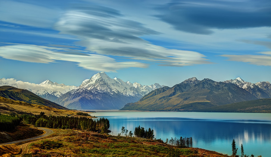The Road to Mount Cook along Lake Pukaki These lenticular clouds are pretty rare — but not on the south island of New Zealand! This is called the land of the long white cloud… I'm not sure of that means these lenticular clouds or not. Maybe a smart reader here on the blog can tell me!Anyway, I do love this photo… I think it is one of my new favorites…- Trey RatcliffClick here to read the rest of this post at the Stuck in Customs blog.