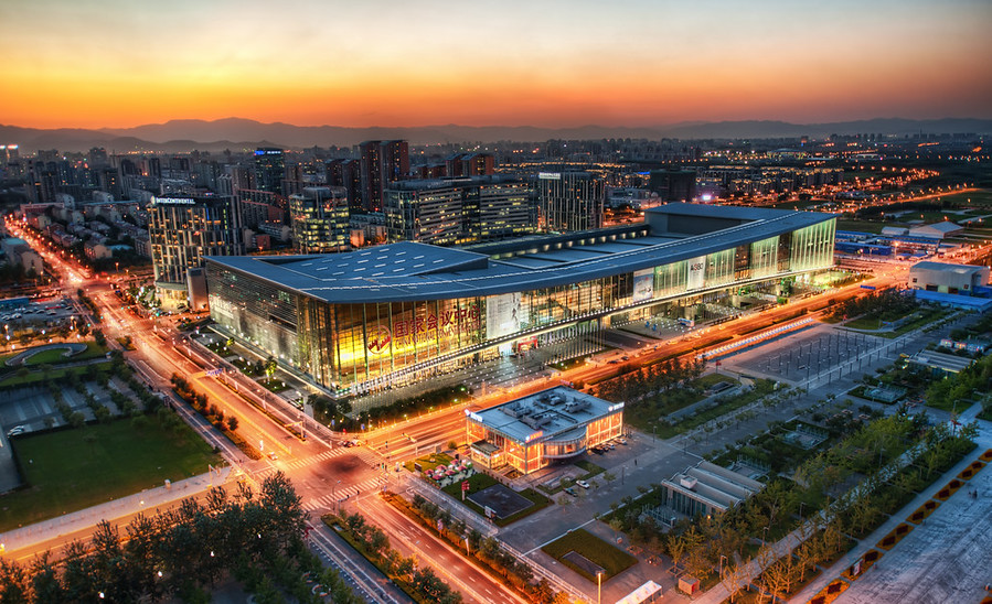 "The CNCCHere is the convention center in Beijing at Dusk. They call it the CNCC. I don't know what that stands for, but I can guess what two of the C's mean.This is a strange thing I have noticed about Beijing. Many people speak in abbreviations. I had many people tell me of the CNCC like it was something I knew perfectly well. I would just end up nodding because when I would ask for what it stood for, they were confused.""You should go to the CNCC!"" they say.""What's that?"" I ask.""Oh, you know! It's the CNCC!"" they respond.- Trey RatcliffRead the rest and see a video of a fairly typical situation in a Chinese cab here at the Stuck in Customs blog."