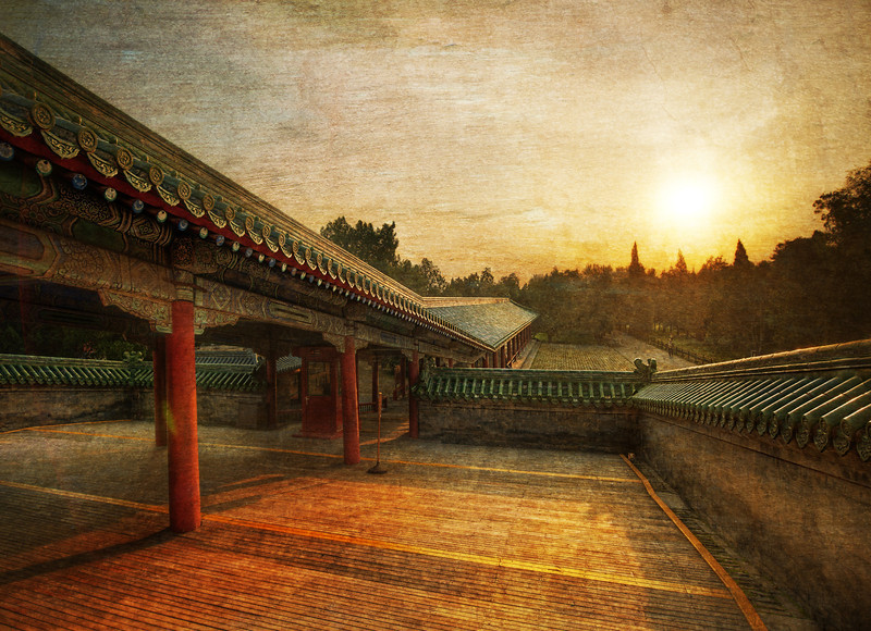 "<h2>The Long Path to the Temple of Heaven</h2> It was a beautiful morning in Beijing. It was cool and crisp, and I walked around this historic area while locals were doing yoga and various other exercises. There are many ancient, repeating structures that cover the grounds in a very orderly manner. This is one of the many long structures that helps to connect various areas of the complex.  - Trey Ratcliff  Read more <a href=""http://www.stuckincustoms.com/2012/01/05/the-long-path-to-the-temple-of-heaven/"">here</a> at the Stuck in Customs blog."