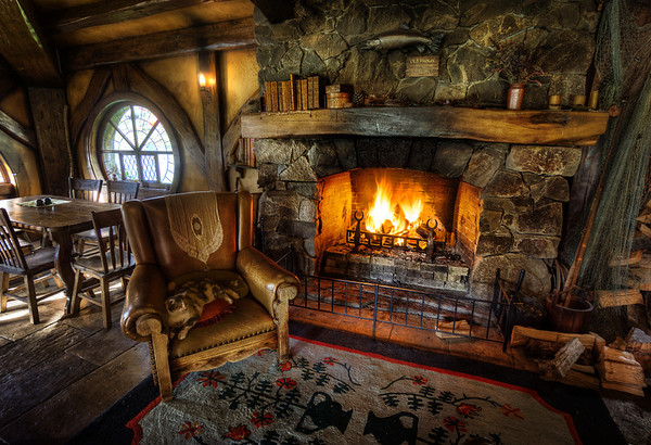"Here is a rather amazing place on the Hobbiton Movie Set — inside the Green Dragon after night has fallen. There is a roaring fire, and I mean absolutely roaring! You may remember this fire as being the thing behind me in the intro to the ""Organize Your Photos!"" tutorial. Man, that thing was so hot behind me, it almost melted me and that dang cat. Of course, Pickles just sat there, taking it all in stride!- Trey RatcliffClick here to read the rest of this post at the Stuck in Customs blog."