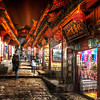 "<h2>Lijiang at Night</h2> <br/>This is the old town of Lijiang, China, where I spent the week with Tom Anderson (the MySpace guy).  I think I mentioned him before.  Anyway, we got to be friends over the past several months, and we ended up spending a week together here in the south of China.<br/><br/>Tom had first been here many years ago when he was setting up the MySpace office in Beijing.  He had great memories, and he thought it would be great for a big return now that he is getting more into photography.  So, it was definitely a week full of non-stop photography action.<br/><br/>One late night after the sun had set, we weaved through the old streets until we found this place.  Looking up, I knew it would be a wonderful place to take a photo, so I set up for this one.<br/><br/>- Trey Ratcliff<br/><br/><a href=""http://www.stuckincustoms.com/2011/10/26/18911/"" rel=""nofollow"">Click here to read the rest of this post at the Stuck in Customs blog.</a>"