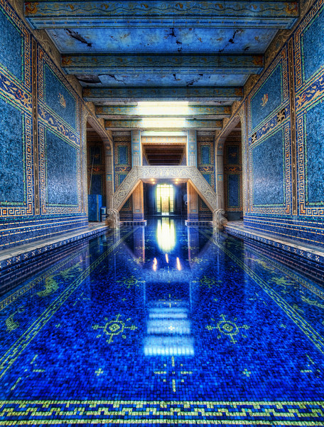 "<h2>The Azure Blue Indoor Pool at Hearst Castle</h2> <br/>I was able to get a private tour throughout Hearst - so that made for an amazing and long day!Thank goodness I had a mass of memory cards... I got so much footage it was crazy!<br/><br/>I could have picked a bunch of shots to be the ""first"", but I thought this one was particularly wonderful.  There are two enormous pools at Hearst Castle, and this is the indoor one.  This is a nice vantage point because this spot is actually quite difficult to reach!  There is no door behind me... so I had to ""shimmy"" along that edge you see... It was NARROW... the shimmy was like a video game, except while holding a $10,000 camera!  Sketchy!  But I just had to get over here because I could visualize the shot before it happened...<br/><br/>Here's a cool fact about this pool.  Nearby, there is a huge room that was intended for a gymnasium that Hearst never constructed.  The State then made it usable for IT and Archive area, so the water cools the computers...  wild, eh?<br/><br/>- Trey Ratcliff<br/><br/><a href=""http://www.stuckincustoms.com/2010/02/01/the-azure-blue-indoor-pool-at-hearst-castle/"" rel=""nofollow"">Click here to read the rest of this post at the Stuck in Customs blog.</a>"
