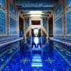 "The Azure Blue Indoor Pool at Hearst Castle I was able to get a private tour throughout Hearst - so that made for an amazing and long day!Thank goodness I had a mass of memory cards... I got so much footage it was crazy!I could have picked a bunch of shots to be the ""first"", but I thought this one was particularly wonderful.  There are two enormous pools at Hearst Castle, and this is the indoor one.  This is a nice vantage point because this spot is actually quite difficult to reach!  There is no door behind me... so I had to ""shimmy"" along that edge you see... It was NARROW... the shimmy was like a video game, except while holding a $10,000 camera!  Sketchy!  But I just had to get over here because I could visualize the shot before it happened...Here's a cool fact about this pool.  Nearby, there is a huge room that was intended for a gymnasium that Hearst never constructed.  The State then made it usable for IT and Archive area, so the water cools the computers...  wild, eh?- Trey RatcliffClick here to read the rest of this post at the Stuck in Customs blog."