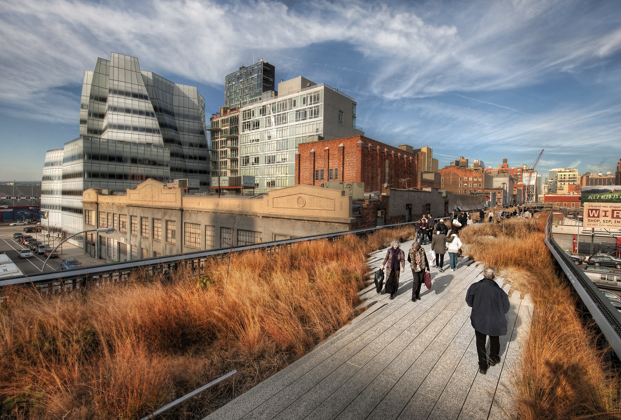 """The Park Through the Sky Isn't this park awesome?  It is an elevated park that weaves along top of New York City.  Hardly anyone knows about it! Of course, people in New York know about it, and they assume that everyone else should know too.  It's relatively new -- I think it only opened a few years ago.  It's called """"High Line Park"""", and it used to have freight trains that ran up and down it back in the 1930's.  That train service is dead, and they converted the entire thing into a long, meandering park. - Trey Ratcliff Read more here at the Stuck in Customs blog."""