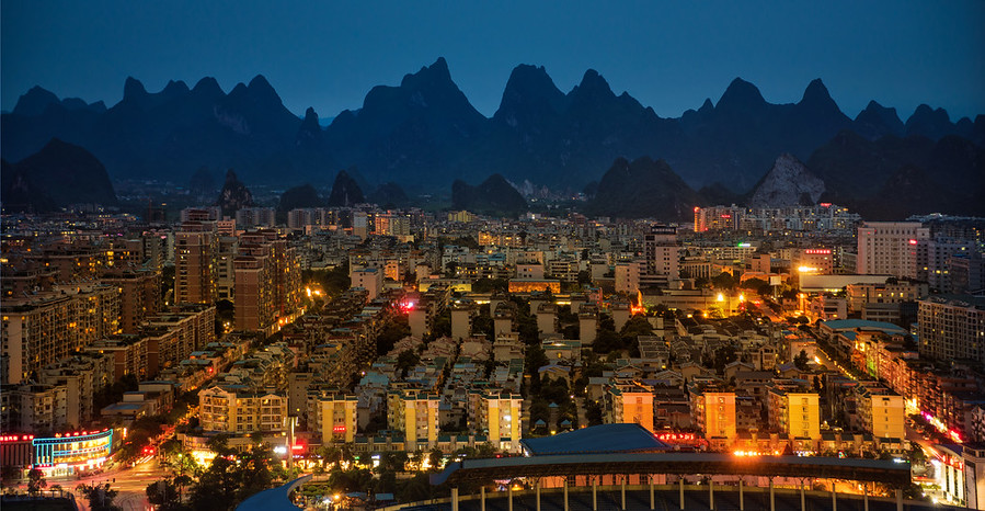 Where the Warm City Meets the Blue Karst Mountains