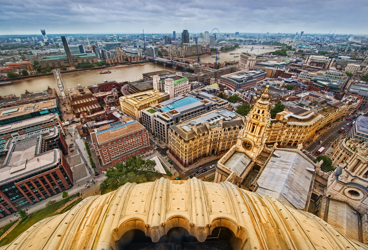 Old London From Above It's a long walk to the top of St. Paul's.  And by long walk, I should throw in that there are a lot of stairs.  But, after you finally arrive, you're greeted by a wonderful view of the city.  As long as you don't have too much of an issue with heights, you'll be in for a treat.Even though I saw all sorts of stuff while I was up there, I enjoyed working on this photo too.  I was able to zoom into 100% and look at all the details and little buildings/bridges/shops once again.  It reminded me of walking around many of them at ground level.- Trey RatcliffRead more here at the Stuck in Customs blog.