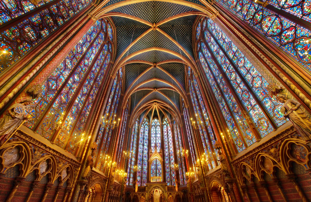 The Light La Sainte-Chapelle is really an amazing place.  I can't believe it took me so many trips to Paris to finally see it.  It wasn't exactly a blind-spot, but I knew it was some place that I had to visit at some point, and I finally got there.  Tripods were forbidden, so I decided to use a tripod to get a shot.    I did manage to squeeze off several rounds until security came up to make me stop.  Of course, the only reason I ignore their rule is because I think it is does not have a solid foundation in logic or rational thought.  I wasn't bothering anyone.  I wasn't going to trip anyone because of the configuration of my tripod and body.  Everything was cool.  - Trey Ratcliff  Read more here at the Stuck in Customs blog.