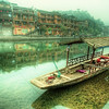"<h2>Still Waters in the Old Town</h2> Feng Huang in the morning is very peaceful.  It might even be one of those towns were a lot of people sleep late, since I didn't see many in the morning.  It was at this very spot that I bruised my ribs pretty bad when I fell down.  It was one of those slick mud-covered concrete areas that doesn't look like a slick mud-covered concrete area.  But once you step on, it's way too late to do anything about it.  There's nothing that knocks the wind out of you more than falling flat on your torso with a Nikon D3S between your ribs and the ground.  I still wince when I think about it!  - Trey Ratcliff  Read the rest of this entry <a href=""http://www.stuckincustoms.com/2011/09/22/still-waters-in-the-old-town/"">here</a> at the Stuck in Customs blog."