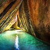 "<h2>The Underwater Cave of Mystery</h2> <br/>This is a very cool place!<br/><br/>There are a thousand boulders that are stacked up all over The Baths area of Virgin Gorda. The beaches are actually separated where the boulders get really intense. This is one of those areas, and to get here, you have to duck and shimmy and slide around. Once you are here, however, you can wade deep into this cave and into other underwater caves beyond.<br/><br/>- Trey Ratcliff<br/><br/><a href=""http://www.stuckincustoms.com/2012/09/03/the-underwater-cave-of-mystery/"" rel=""nofollow"">Click here to read the rest of this post at the Stuck in Customs blog.</a>"
