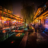 "<h2>Dark and Light in Lijiang</h2><br/>Here's a photo that I edited live during the class a few days ago. The motions I went through are also inside of one those ""Trey's Lightroom Presets"" I mentioned a few days ago… you can do so much in Lightroom nowadays that it is kind of scary!<br/><br/>This is one of the main streets in the city of Lijiang. During the day, it looks quite traditional, but at night, everything lights up and becomes wonderfully alive.<br/><br/>- Trey Ratcliff<br/><br/><a href=""http://www.stuckincustoms.com/2012/08/08/new-york-photowalk-soon/"" rel=""nofollow"">Click here to read the entire post at the Stuck in Customs blog.</a>"
