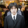 "<h2>Salaryman in Tokyo</h2> <br/>While I was in the middle of making a time-lapse sequence (see the video below the photo), I was using my D3S on a sling to take quick photos of interesting people. They were everywhere!<br/><br/>Behind me, waiting for the light to change, was this young salaryman. Salaryman is the Japanese word for ""businessman"". That word salaryman always cracks me up for some reason. Anyway, he was this young kid, standing there in a most unassuming way in this nice suit. I spun around and grabbed a quick shot.<br/><br/>He looked a little confused at me after I took it. I gave him a nod of thanks, and he smiled in a surprised way then went merrily on his way. <br/><br/>- Trey Ratcliff<br/><br/><a href=""http://www.stuckincustoms.com/2010/10/03/five-tips-for-photographing-people/"" rel=""nofollow"">Click here to read the rest of this post at the Stuck in Customs blog.</a>"