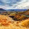 "<h2>The Valley Between Queenstown and Arrowtown</h2><br/>See that area down there? We're in the middle of an epic house-hunting adventure right in the middle of it all.<br/><br/>I took this photo a few days ago on a drive to Wanaka. It was so pretty, I just had to pull over to take it! In fact, maybe I need to make this drive more often!<br/><br/>In the far distance is Queenstown, which is only about 15-20 mins from this spot. Down to the right, just beyond the edge, is nearby Arrowtown. I think there are about 1 million photographs somewhere in between.<br/><br/>- Trey Ratcliff<br/><a href=""http://www.stuckincustoms.com/2012/06/20/the-valley-between-queenstown-and-arrowtown/"" rel=""nofollow"">Click here to read the entire post at the Stuck in Customs blog.</a>"