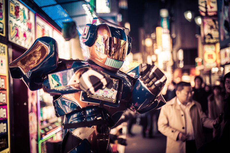 Robots in the Streets of Tokyo! Someone gave me a hot tip to go see this cool robot area of Tokyo! There's a place called the Robot Restaurant, and it's one of the craziest places I have ever been!It's basically like Medieval Times, but with robots and girls in bikinis.Outside the Robot Restaurant, they have all these awesome-looking robots with iPads on their chests. There are people inside, which is kind of a disappointment, but also kind of a relief. Either way, they are pretty awesome!- Trey RatcliffClick here to read the rest of this post at the Stuck in Customs blog.