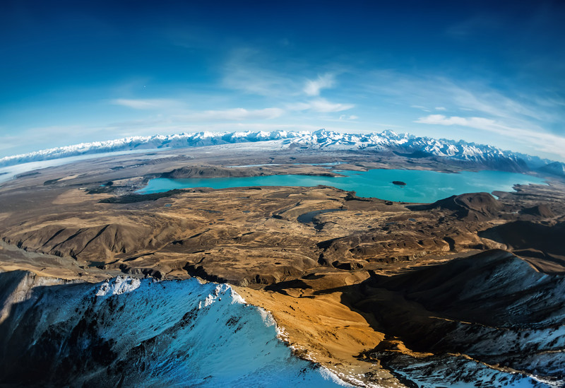 "<h2>Over Lake Tekapo</h2> <br/>Here's one of my favorite images from that day in the chopper. Shooting from a helicopter is always tough. If you watched that video, you'll see I switched a lot between different cameras. Even though I am using the Sony NEX-7 a lot, I chose the Nikon here because of the extreme conditions. I was quite worried I would only get a few minutes to shoot, so I wanted to make sure I did not run into any buffering problems… this is why I went with the Nikon.<br/><br/>Don't know what buffering is? That is what happens when you take a whole bunch of photos in a row and the camera has to save them quickly. On lesser cameras, sometimes you can only take a few photos before there is a long pause while it writes the photos. The NEX-7 lets met get in about 10-13 photos before it starts going slow. The Nikon D3s lets me take about 30+ I think!<br/><br/>- Trey Ratcliff<br/><br/><a href=""http://www.stuckincustoms.com/2013/06/24/more-about-project-loon/"" rel=""nofollow"">Click here to read the rest of this post at the Stuck in Customs blog.</a>"