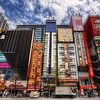 "<h2>Akihabara Street</h2> <br/>It took me many days in Tokyo before I finally made it over to one of my favorite areas - Ahikabara. This district is famous for its pure technology insanity!  If you are a geek, then this is geek heaven!<br/><br/>Every street is filled with huge towers, each one flowing over with all sorts of technology, gadgets, games, robotics, toys, and scantily-clad-women.  The streets are filled with girls that dress in... hmmm... how do I explain it?  Imagine a grown woman wearing little-girl clothes, with puffy-laced mini-skirts, giant bows, and comely dispositions.  They stand around, handing out little flyers, trying to get you to come into a shop, a cafe, or something in between.<br/><br/>There is even a cafe there with monitors built into the table.  When you order a drink, your waitress goes over to the soda fountain, where a camera lies in the floor pointing upward.  Upon pressing a special button, an extra blast of air is strategically blasted to increase your viewing cone.<br/><br/>- Trey Ratcliff<br/><br/><a href=""http://www.stuckincustoms.com/2010/05/01/akihabra-street-geek-heaven/"" rel=""nofollow"">Click here to read the rest of this post at the Stuck in Customs blog.</a>"