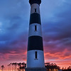 "<h2>Lighthouse on Roanoke Island at Sunset</h2> <br/>Ahhhh - finally a good sunset!  I keep track of the sunsets like an insane meteorologist combined with a native-American shaman.  I do my best to look at each day and figure out how things will end up that evening.  Predicting more than a day ahead is almost impossible, unless you are at a special place on the planet around a certain type of year.<br/><br/>On this day in North Carolina, I knew that the late afternoon storm was a small cell, and it would pass quickly, perhaps letting the sun peak beneath the clouds to light them from the bottom.  And, to my satisfaction, it actually happened!<br/><br/>- Trey Ratcliff<br/><br/><a href=""http://www.stuckincustoms.com/2012/03/06/lighthouse-on-roanoke-island-at-sunset/"" rel=""nofollow"">Click here to read the rest of this entry at the Stuck in Customs blog.</a>"