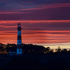 "<h2>Roanoke Island Lighthouse</h2> <br/>I'm visiting family for Thanksgiving here on Roanoke Island, and I went out last night after a storm to take some photos. This area is known for beautiful lighthouses, so I put myself on a little mission.<br/><br/>I didn't initially plan on going out to take photos. It started with a jog on the beach a bit before sunset. I was jogging north, listening to good music, and the sun was on me. But, ahead of me, the clouds were dark and scary, like the ones circling Mordor. One of those surreal scenes unfolded in front of me… maybe you know the kind. The sun lit everything perfectly below the horizon, and above the horizon was heavy and foreboding. It was then that I decided that it would be an interesting night for photos!<br/><br/>So I jogged back to the house, got my rig, and headed out. All this while, I was still in shorts and a t-shirt, which were now wet with rain since the clouds had come to cover me up on the way home. I drove to this nearby lighthouse, but there was no good way to get this angle. The trees in front were about eight feet high, and there was no break in them… the only thing I could do is pull my car over (a rented minivan), and climb up on top with my tripod. There are not many things more slippery than the top of a wet minivan! So, I'm sure I looked like quite a fool clambering my way up there… but up there I got.<br/><br/>- Trey Ratcliff<br/><br/><a href=""http://www.stuckincustoms.com/2011/11/24/roanoke-island-lighthouse/"" rel=""nofollow"">Click here to read the rest of this post at the Stuck in Customs blog.</a>"