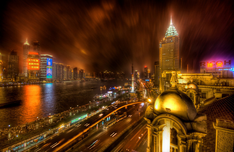 "<h2>The Bund in the Rain</h2> <br/>This is shot from the old British part of Shanghai called the Bund. The rain was bitter rough that night and I was on the roof, but I managed to get in position and stay dry enough (for a moment) for this one.<br/><br/>- Trey Ratcliff<br/><br/><a href=""http://www.stuckincustoms.com/2008/04/10/the-bund-in-the-rain/"" rel=""nofollow"">Click here to read the rest of this post at the Stuck in Customs blog.</a>"