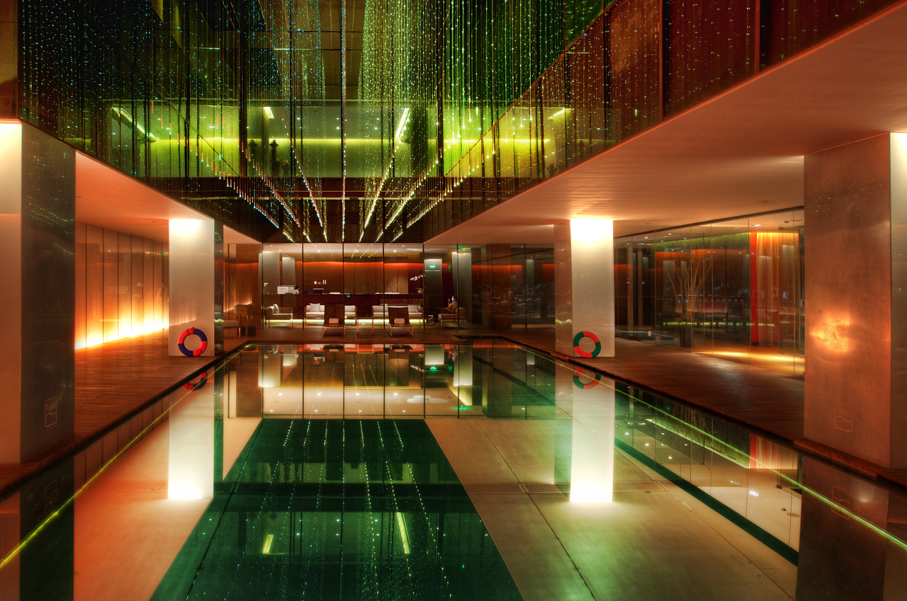 The Opposite Hotel What an amazing hotel in the heart of Beijing!  Thank you all for the suggestion to go here...  I love this kind of neo-modern-techno architecture, so it was a real treat to run around and take photos everywhere.  I was like a man possessed :)This is the lower pool area.  It was dark in there for sure.  I used a tripod to make sure the exposure was long enough to get the effect I was going for.The video on the right is from another part of the hotel... up in my room... where you can see some cool things as well as what was in my bag.- Trey RatcliffClick here to read more, including an exciting announcement for Android fans, at the Stuck in Customs blog.