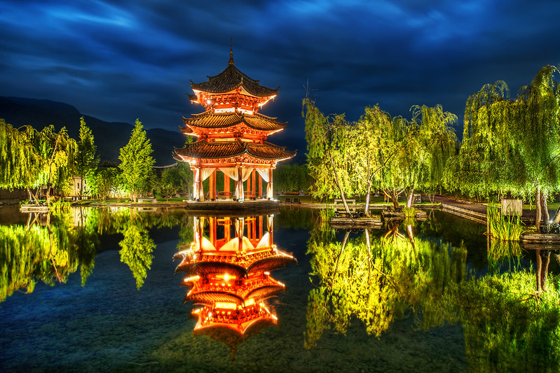"<h2>The Nameless Pagoda Sleeps</h2><br/>Tom and I visited this Pagoda late one evening in Li Jiang. There was zero wind, so the perfect reflection made us happy. The thing that did not make us happy was having to get on the ground with our tripods in the lowest position. I do try to avoid getting on the ground as often as possible… but when the scene is right, I guess I have no choice!<br/><br/>- Trey Ratcliff<br/><br/><a href=""http://www.stuckincustoms.com/2012/08/04/the-nameless-pagoda-sleeps/"" rel=""nofollow"">Click here to read the entire post at the Stuck in Customs blog.</a>"
