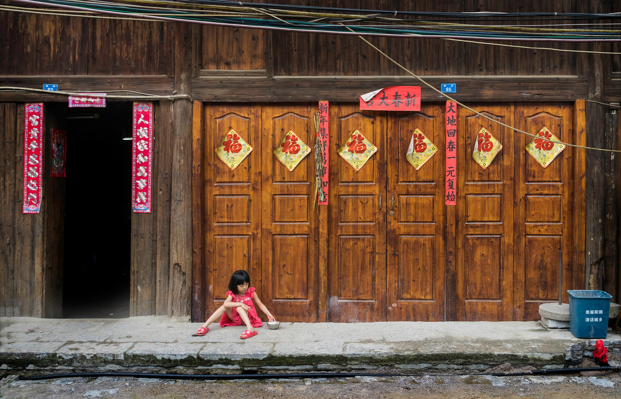 Little Girl Eating Rice near Yangshao
