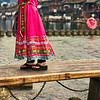 "<h2>Walking Across the Old Bridge</h2> While in China, one of the small towns I visited had several little low walking-bridges across the river.  It was the sort of river that was too shallow for boats, but good for fishing and washing clothes.  This one was in a residential and commercial area.  Many of the women wore colorful dresses and walked back and forth across... it all seemed very nice and peaceful so I grabbed an image.  - Trey Ratcliff  Read more <a href=""http://www.stuckincustoms.com/2011/07/10/walking-across-the-old-bridge/"">here</a> at the Stuck in Customs blog."