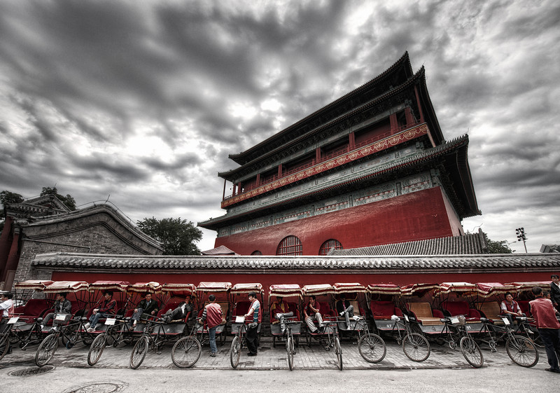"<h2>Rickshaws at the Drum Tower</h2> <br/>I've visited Gǔlóu many times and never taken a photo.  I just couldn't figure one out.<br/><br/>And then, this most recent trip, I walked around the tower several times until I finally got an idea.<br/><br/>This is the giant drum tower built about a thousand years ago by Kublai Khan.  An enormous drum rests in front, and it was beat rhythmically to announce meetings. The temple sits in the Inner City to the north of Di'anmen Street.<br/><br/>- Trey Ratcliff<br/><br/>Read more, including a preview of an exciting announcement, <a href=""http://www.stuckincustoms.com/2011/10/21/rickshaws-at-the-drum-tower/"">here</a> at the Stuck in Customs blog."