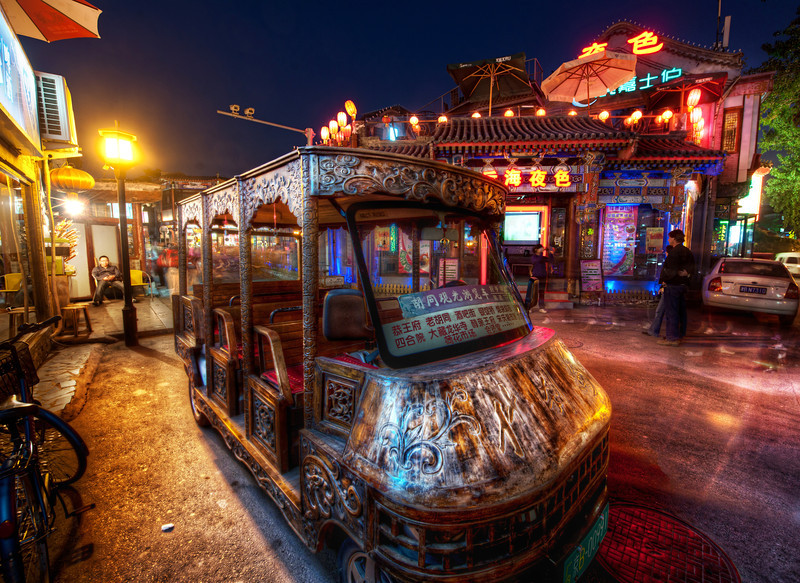 """<h2>Ornate Taxi in Beijing</h2> <br/>This little taxi reminded me a bit of those crazy Burning Man cars! It parked here for just long enough for me to grab a photo. After it left, I realized that I think wanted a ride in it… but I was too busy getting lost in taking the photo to keep my wits about me.<br/><br/>- Trey Ratcliff<br/><br/><a href=""""http://www.stuckincustoms.com/2013/01/10/ornate-taxi-in-beijing/"""" rel=""""nofollow"""">Click here to read the rest of this post at the Stuck in Customs blog.</a>"""