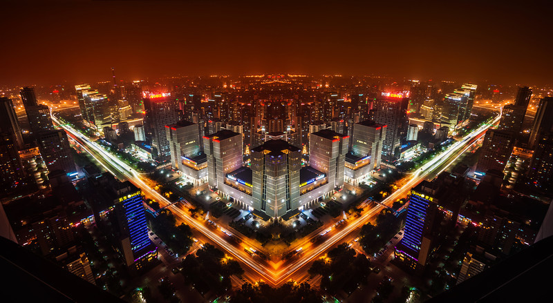 "<h2>The Sprawling City</h2> <br/>I'm experimenting with this style of city photography. I like this idea of reflection that is imperfect. I shot this from the top of one of the only television stations in Beijing. It was a perfect night without any wind. There was a lot of pollution, so the warm city lights cast a red glow into the ether…<br/><br/>- Trey Ratcliff<br/><br/><a href=""http://www.stuckincustoms.com/2013/07/12/the-sprawling-city/"" rel=""nofollow"">Click here to read the rest of this post at the Stuck in Customs blog.</a>"