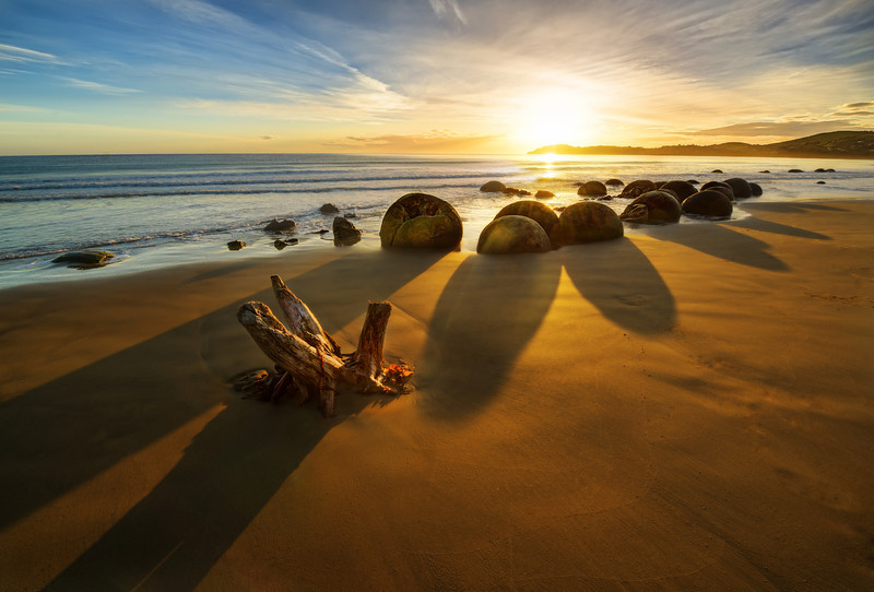 "<h2>Moeraki Boulders at Sunrise</h2> <br/>A group of people from NZIPP went out for an overnight road trip to this amazing place on the east coast. I've always wanted to shoot them at sunrise, but it kind of requires you to sleep pretty close by. I live in Queenstown, which is about 3-4 hours away, and that would mean a 2 AM wake-up time in the summer!<br/><br/>One of the tricky things about these boulders is ensuring you arrive at low-tide. At high-tide, they are almost totally inaccessible… so timing a sunrise with a low-tide takes a bit of planning. Thanks to Jason Law and NZIPP for the nice invite!<br/><br/>- Trey Ratcliff<br/><br/><a href=""http://www.stuckincustoms.com/2012/12/01/road-trip-to-the-moeraki-boulders/"" rel=""nofollow"">Click here to read the rest of this post at the Stuck in Customs blog.</a>"