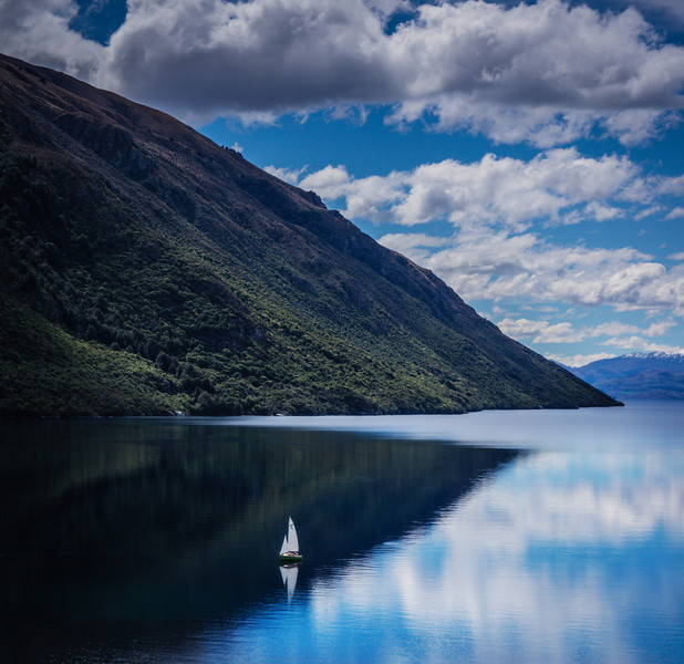 "<h2>Sailing on Lake Wakatipu</h2> <br/>The car trip started here in Queenstown on Lake Wakatipu. It was a perfect spring day, and there was a lone sailboat down on the lake. Everything is on such a big scale here, maybe you can get a sense of the overall size of the lake from the tiny sailboat on there… it looks like a toy!<br/><br/>- Trey Ratcliff<br/><br/><a href=""http://www.stuckincustoms.com/2012/11/04/more-from-the-new-zealand-car-trip/"" rel=""nofollow"">Click here to read the rest of this post at the Stuck in Customs blog.</a>"