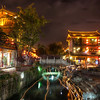 "<h2>The Ancient Town of Lijiang</h2> This was a very long exposure -- about five minutes or so. I did this so I could help make most of the people disappear from the scene. It also had a nice side-effect down in the river. People would light candles and float them downstream, and the path they followed came out as little golden streaks.  - Trey Ratcliff  Read the rest of this entry and some info on tonight's huge YouTube Live hangout <a href=""http://www.stuckincustoms.com/2011/10/05/the-ancient-town-of-lijiang/"">here</a> at the Stuck in Customs blog."