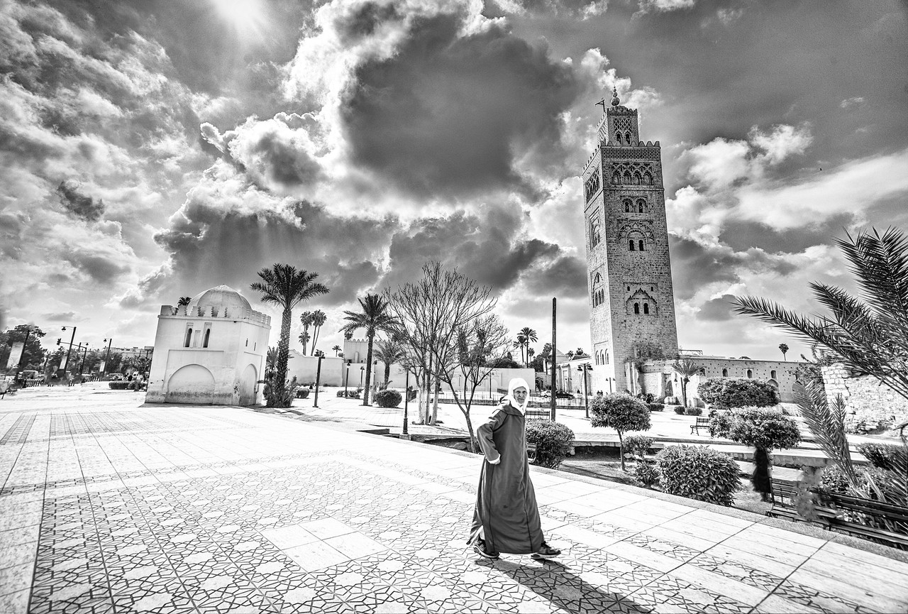 Man Walking In Marrakech At The Koutoubia Mosque