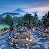 "<h2>The Hidden Buddhist Temple of Borobudur at Sunrise</h2> <br/>This morning I got a wakeup call at 3:30 AM to head out on a distant trek to Borobudur to climb the temple before sunrise.  I had a flashlight and a fully loaded iPod for the ascent.  I stayed at the top and all around the temple for most of the morning, collecting shots here and there as misty clouds rolled in, through, around, and over the temple.<br/><br/>This temple laid abandoned and overgrown for about 800 years until it was rediscovered by the British.<br/><br/>You can see the distant volcano rumbing in the morning sunrise...<br/><br/>- Trey Ratcliff<br/><br/><a href=""http://www.stuckincustoms.com/2008/03/16/the-hidden-buddhist-temple-of-borobudur-at-sunrise/"" rel=""nofollow"">Click here to read the rest of this post at the Stuck in Customs blog.</a>"