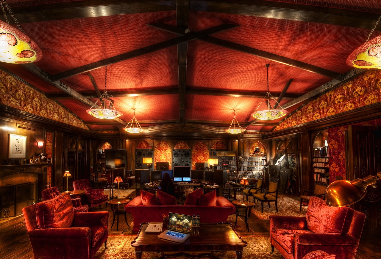Hans Zimmer's Studio I don't know if words do it justice, but I hope these photos do. The studio is even bigger than I thought, and I was reminded of the Crimson Lounge in Chicago.  In fact, I pulled up the image on my laptop there on the table to compare textures and light.  I thought everything worked well together -- the decadence and richness of the decorations integrated with the technology.   I don't know if there is a word for such a look... It's something out of a Phillip Pullman novel, somewhere between Steampunk and Techno-boudoir.  Again, words fail.The first two photos I have placed on Flickr.  You can click on them to go to Flickr and then zoom into the full-res size.  Amazing details -- especially in the chair photo. I'll post more in coming weeks, months, and years, as usual.  So, stay tuned... my ongoing quest continues!- Trey RatcliffClick here to read the rest of this post at the Stuck in Customs blog.