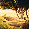 "<h2>Old Boat by the Seashore</h2> <br/>I was near Moeraki and taking photos at sunset. This was the only night I was there, and I was excited to eat at this legendary place I keep hearing about called ""Fleur's"" — so I was extra-bummed to find out it happened to be closed on that one night in particular. What a bummer. But I walked around the back side to explore and saw this boat up by this tree…<br/><br/>- Trey Ratcliff<br/><br/><a href=""http://www.stuckincustoms.com/2013/07/15/old-boat-by-the-seashore/"" rel=""nofollow"">Click here to read the rest of this post at the Stuck in Customs blog.</a>"