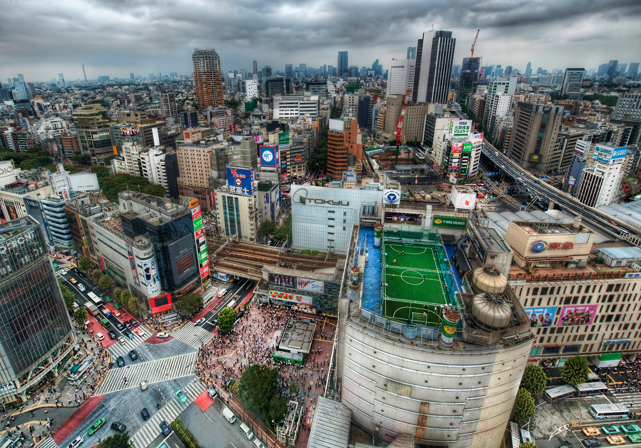 "Tokyo from the Air Wow this city is amazing.  I have to go back soon!I found one of the tallest buildings and scooted my way around inside until I found an elevator to the top.  On the way up, I was lucky to be on a glass elevator.  I was as shocked as you when I saw that soccer field on top of a building!  How cool!  I'd love to get up there and play around with those guys.  If you'd like to see the details there, or anywhere else, be sure to see the original sized version.  You can find that by following the photo to the Flickr site, clicking on ""All Sizes"" and then ""Original"".- Trey RatcliffClick here to read the rest of this post at the Stuck in Customs blog."