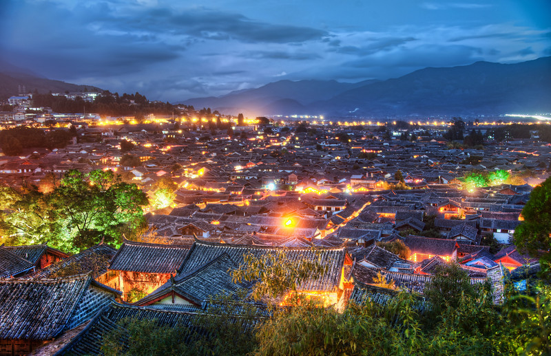 "<h2>The Village of Lijiang</h2> I tried to get this shot for almost a week!<br/><br/>It turns out there is a hill/mountain that requires significant planning and calories to ascend for this dusky time falls.  And I kept miscalculating the time with Tom.  We always thought the sunset would be a little later than it was.  And then we would start to get up into position, and we realized it was too late -- so we went to go do something else instead.<br/><br/>This evening, I would snap a few photos and then sit down with my sketch pad and work on a few drawings.  I'd wait about 10 minutes for the light to change between photos... and it was nice just to listen to music and play around with some sketching-ideas...<br/><br/>- Trey Ratcliff<br/><br/><a href=""http://www.stuckincustoms.com/2012/03/28/the-village-of-lijiang/"" rel=""nofollow"">Click here to read the entire post at the Stuck in Customs blog.</a>"