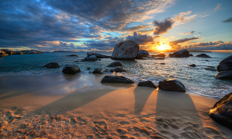 "<h2>A Tropical Sunset</h2> <br/>I did a lot of snorkeling out in that bay. This whole area of Virgin Gorda is called The Baths, and it has some of the best beaches in the world. There are basically no waves of any consequence. So, if you're just learning to snorkel, it's a perfect environment. The kids had a lot of fun here too… lots of private little alcoves and caves!<br/><br/>- Trey Ratcliff<br/><br/><a href=""http://www.stuckincustoms.com/2013/05/18/a-tropical-sunset/"" rel=""nofollow"">Click here to read the rest of this post at the Stuck in Customs blog.</a>"