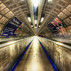 "<h2>The People Mover</h2>  This is London, right?  I'm embarrassed to say I can't quite remember.  I processed and edited this photo as part of a bigger trip.  I'm too lazy to check the EXIF and cross-reference the dates... even though that would have taken less time than writing this sentence.  But, instead, I'm saying it like this to let you know that sometimes my memory fades a bit.  Some spots I remember perfect perfect perfect perfect... and others fade away and drift into others.  I'm not sure why memory works like this...  why there are some things that are perfect and some that are fuzzy.  The way that memory works in this incomplete way is interesting to me.  - Trey Ratcliff  Read more <a href=""http://www.stuckincustoms.com/2011/06/17/the-people-mover/"">here</a> at the Stuck in Customs blog."