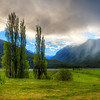 "<h2>Gentle Hills and Summer Storm in New Zealand</h2> While driving from Nelson to the south, we went through an area with many vineyards and pastoral scenes.  I mean, it doesn't get any more pastoral than this.  In fact, it's so pastoral, it's almost a time-warp and everything is in slow motion.<br><br>I stopped the car and jumped over a fence to walk out into a field to frame this shot.  I thought it might work from the road, and I was in a bit of a hurry to get this weather system before it moved along too far.<br><br>- Trey Ratcliff<br><br><a href=""http://www.stuckincustoms.com/2012/01/20/gentle-hills-and-summer-storm-in-new-zealand/"" rel=""nofollow"">Click here to read the entire post at the Stuck in Customs blog.</a>"