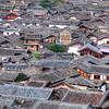 "<h2>Across the Top of the Old Village</h2> The old town of Lijiang has these old rooflines that go forever to the horizon.  Part of the problem getting up above the roofline is, well, getting up above the roofline.  You have to head a bit out of town and walk up a hill to get this perspective.  I found the spot thanks to Stuck On Earth.<br/><br/>- Trey Ratcliff<br/><br/><a href=""http://www.stuckincustoms.com/2012/04/17/across-the-top-of-the-old-village/"" rel=""nofollow"">Click here to read the rest of this post at the Stuck in Customs blog.</a>"