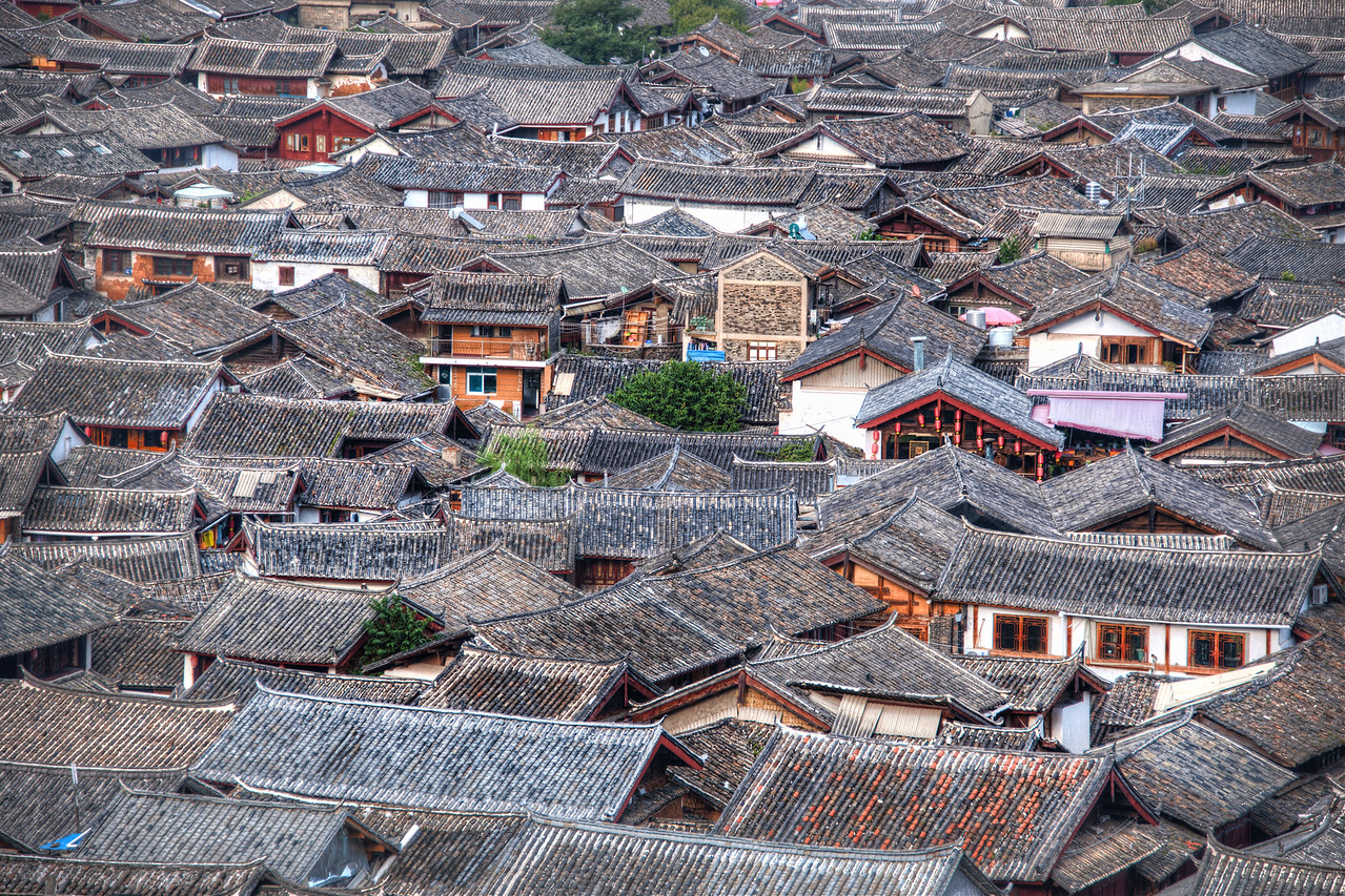Across the Top of the Old Village The old town of Lijiang has these old rooflines that go forever to the horizon.  Part of the problem getting up above the roofline is, well, getting up above the roofline.  You have to head a bit out of town and walk up a hill to get this perspective.  I found the spot thanks to Stuck On Earth.- Trey RatcliffClick here to read the rest of this post at the Stuck in Customs blog.