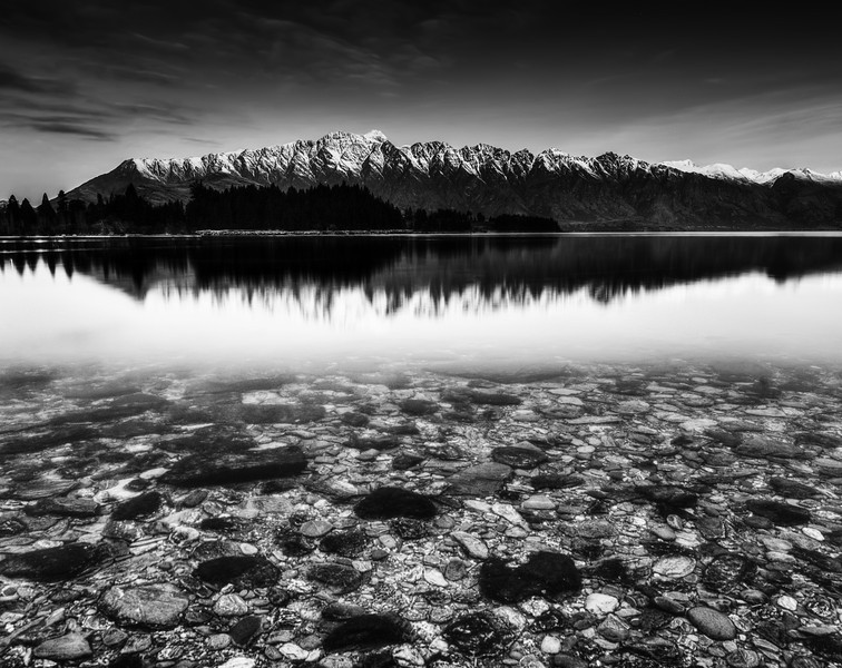 "<h2>The Rocks Near and Far</h2><br/>A few nights ago I went for a walk along the water's edge here in Queenstown. About one out of ten nights (or, as far as I have measured), there is a clear night with a bright pink light that shoots up from behind those mountains. It's really quite a sight.<br/><br/>I went down to the edge of the lake and buried my tripod legs in the frigid, icy-clear water. Even though the color of the light was so nice, in the end it was not as interesting as the light itself.<br/><br/>- Trey Ratcliff<br/><br/><a href=""http://www.stuckincustoms.com/2012/06/24/the-rocks-near-and-far/"" rel=""nofollow"">Read the entire post at the Stuck in Customs blog.</a>"